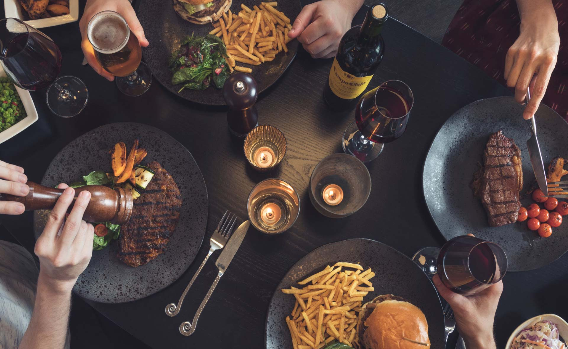 Plain Creative Project Waltons Bar and Grill - meals on table